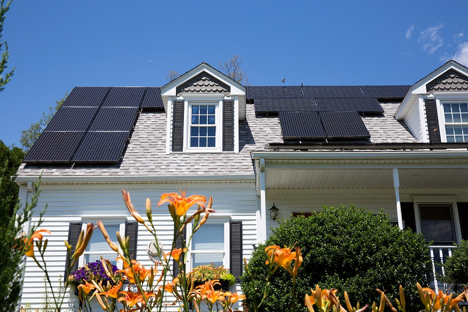 Solar panel installation on a nice cape house with sunny blue skies in the background