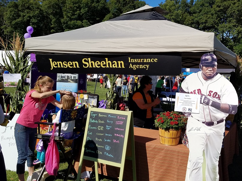 face painter painting in front of Jensen Sheehan table