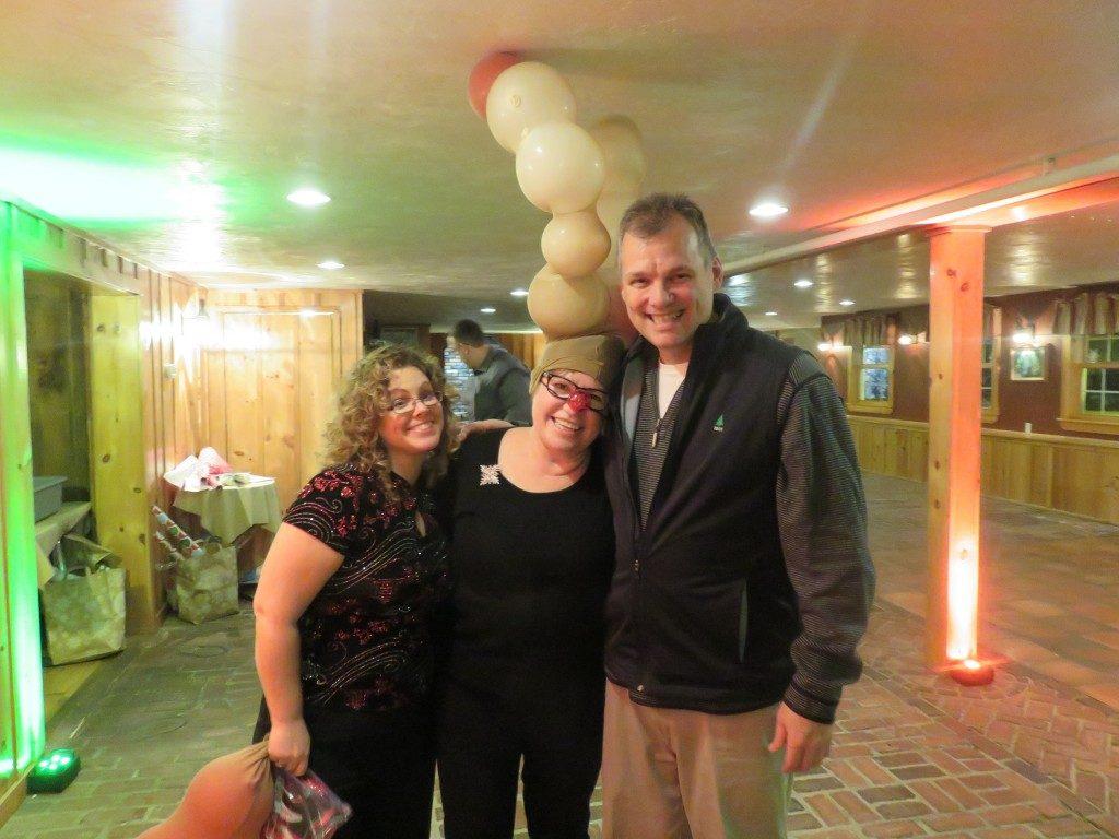 Steve, Jean, Krishna at the company Christmas party.