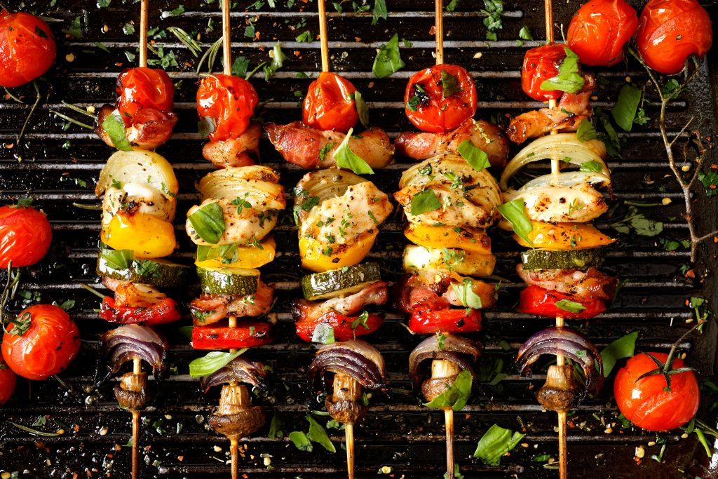 Colorful food cooking on a grill