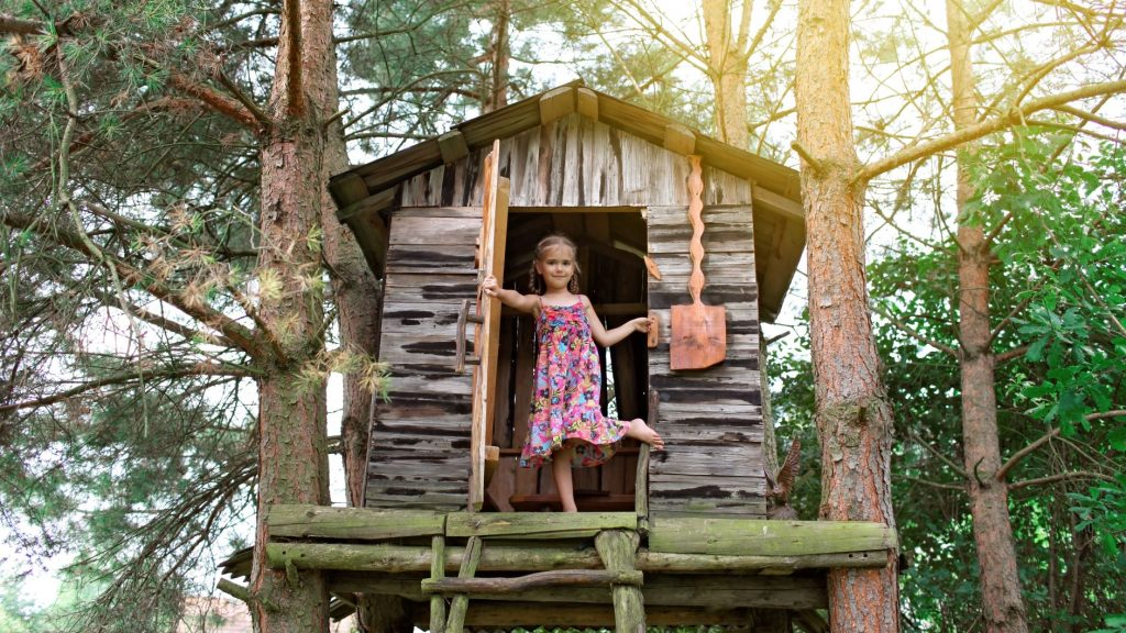 Girl playing in a tree house