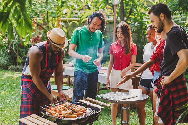 Group of people having barbecue/barbeque party at home